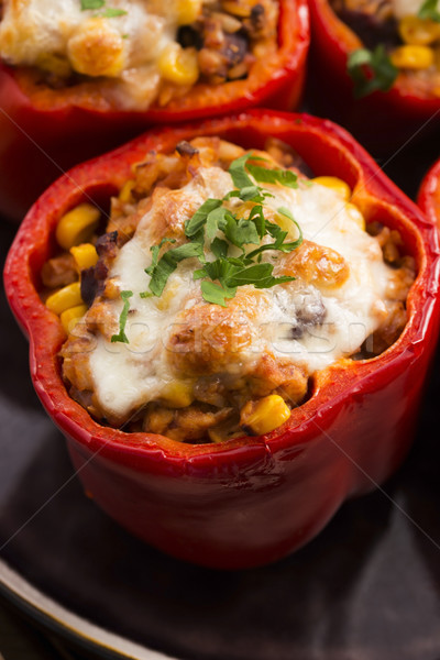 Stuffed peppers with meat, kidney beans and corn Stock photo © joannawnuk