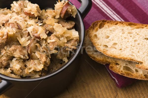 traditional polish sauerkraut (bigos) with mushrooms and plums Stock photo © joannawnuk