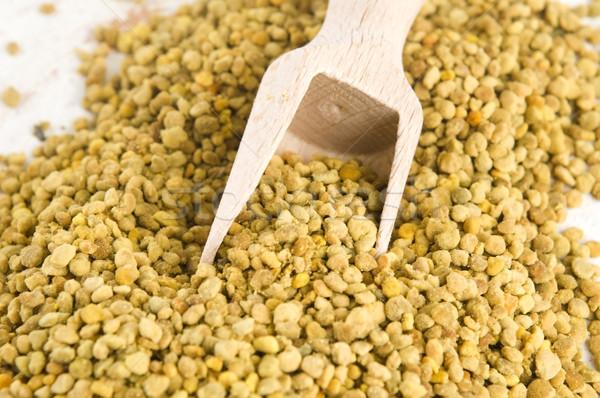 Bee pollen in wooden scoop. Nutritional supplement Stock photo © joannawnuk