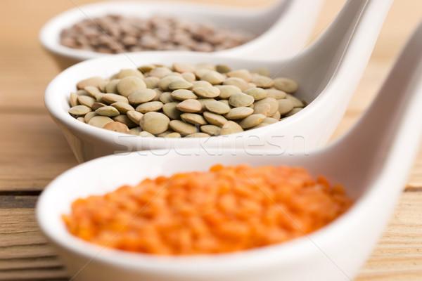 Three kinds of lentil in bowls - red lentil, green lentil and br Stock photo © joannawnuk
