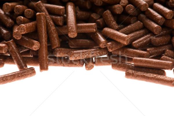 chocolate sprinkles on white background Stock photo © joannawnuk