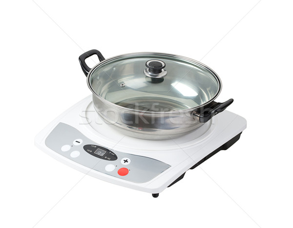 Electric stove with empty pot the necessary kitchenware Stock photo © JohnKasawa