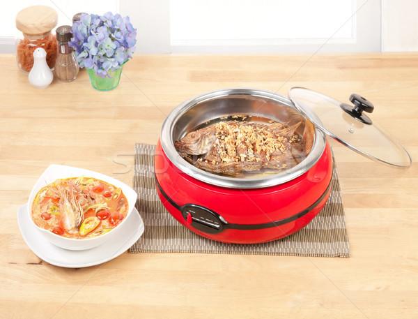 Deep fried fish and Shrimps spicy soup let's cooking asain food  Stock photo © JohnKasawa