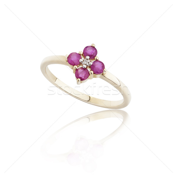 Ruby ring on golded body shape the most luxurious gift Stock photo © JohnKasawa
