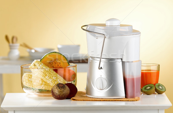 Makes variety fruits juice by maker blender machine in the kitch Stock photo © JohnKasawa