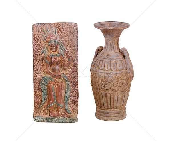 nice clay vase and ancient style angel statue of Khmer empire Stock photo © JohnKasawa