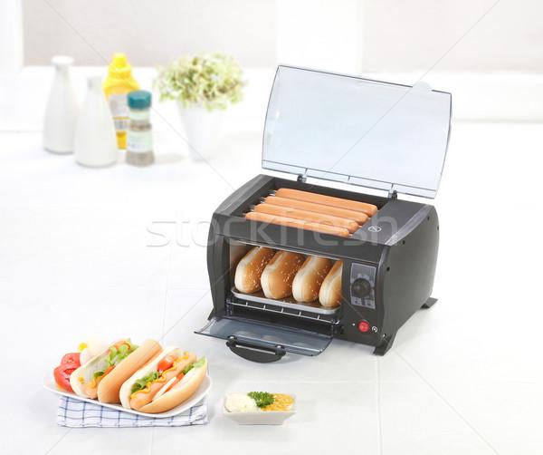 Burger and sausages grill machine Stock photo © JohnKasawa