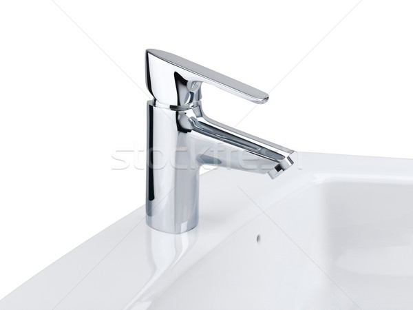 Nice design of the chrome faucet and white washbasin Stock photo © JohnKasawa