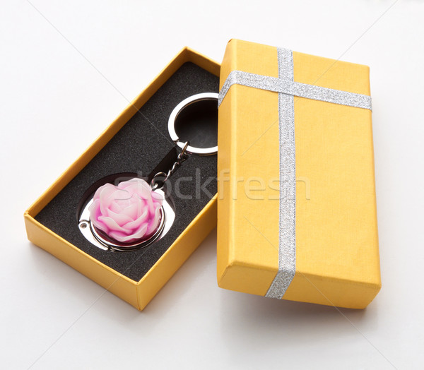 Stock photo: Pink rose keychain store in the beautiful yellow box