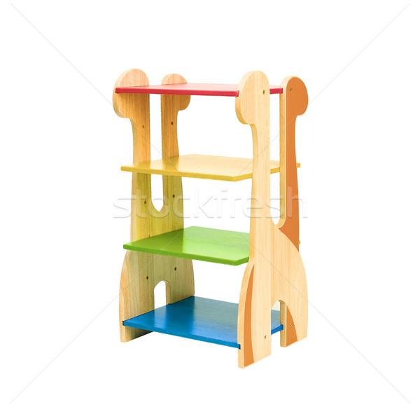 Colorful empty wooden Giraffe shelf for kids to putting there st Stock photo © JohnKasawa