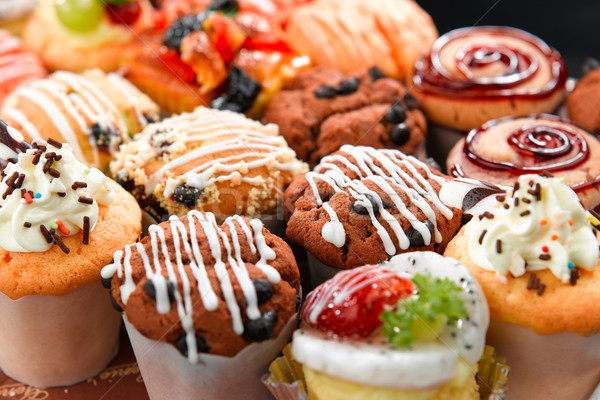 Colorful muffins in variety flavor Stock photo © JohnKasawa