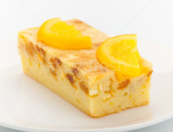 Orange cake melted with pieces of orange and topping on it for d Stock photo © JohnKasawa