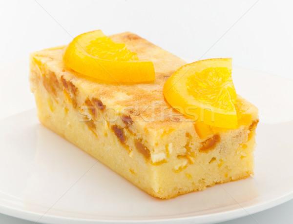 Narancs torta olvadt darabok születésnap eszik Stock fotó © JohnKasawa
