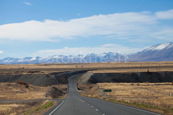 Route view to Tekapo town with Souther Alaps valleys background  Stock photo © JohnKasawa