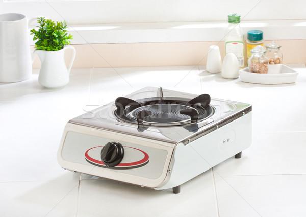 Gas stove with empty gas plate new kitchenware  Stock photo © JohnKasawa
