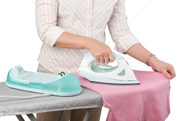 A woman ironing her cloth isolated   Stock photo © JohnKasawa