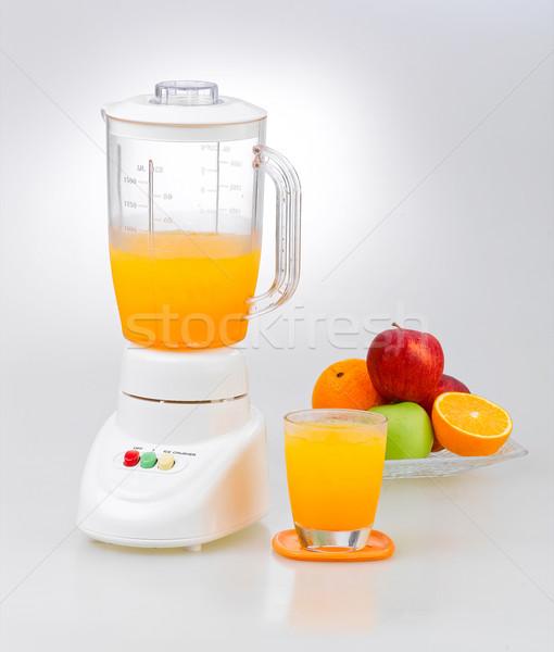 Fruits and orange juice blender Stock photo © JohnKasawa