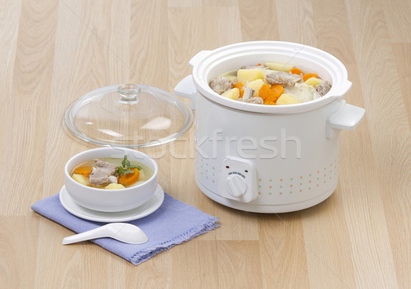 Electric casserole or stew pot on the wooden kitchen table Stock photo © JohnKasawa