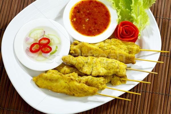 Grilled pork stick a special Thai favorite snack food on dish Stock photo © JohnKasawa