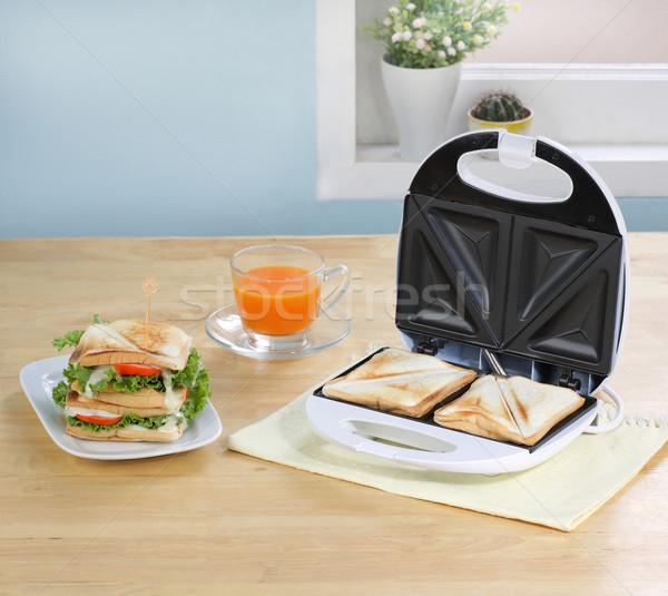 Sandviçler makine mutfak ev turuncu ekmek Stok fotoğraf © JohnKasawa
