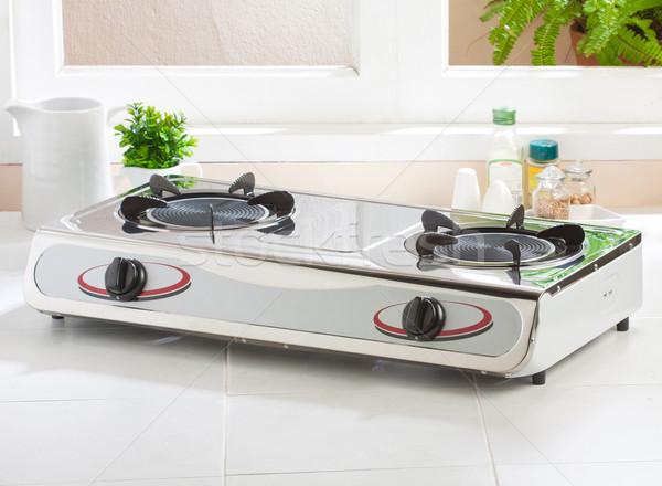Gas stove with empty gas plate on the kitchen Stock photo © JohnKasawa