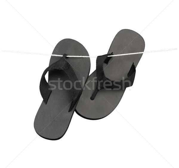 Black slippers hang on the rope on white  Stock photo © JohnKasawa