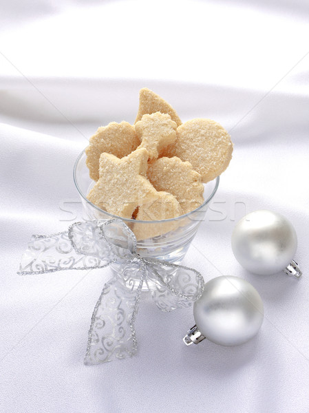 Butter cookies on the glass tie with ribbon on bright fabric bac Stock photo © JohnKasawa