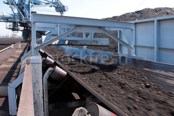Machine belt transporting the mass of lignite to the tower plant Stock photo © JohnKasawa