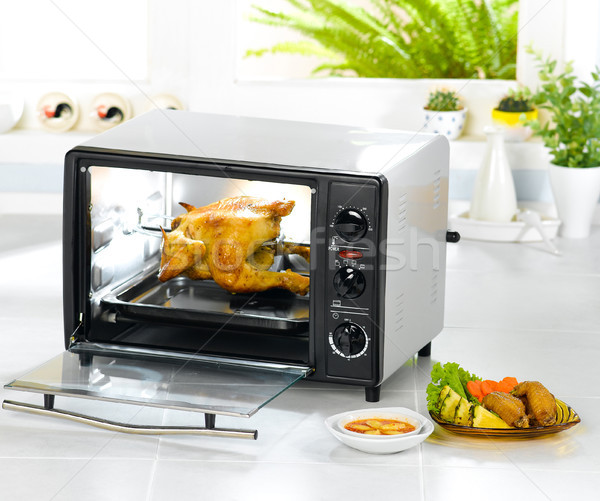 Electric chicken roast oven fast and convenience kitchenware Stock photo © JohnKasawa