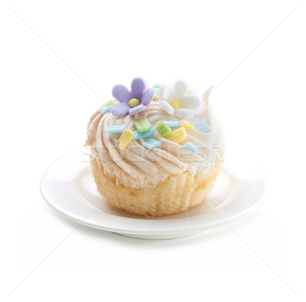 Cupcake topping with icing flowers isolated on white dish Stock photo © JohnKasawa