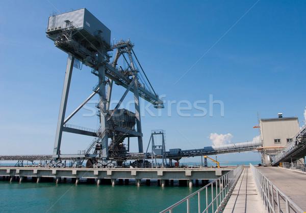 Big crane in the jetty reach to supporting the tanker marine shi Stock photo © JohnKasawa