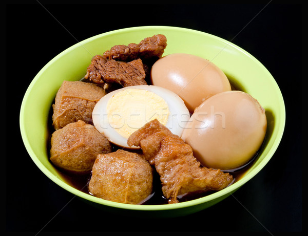 Casseroled pork and eggs with old fashioned asian gravy Stock photo © JohnKasawa