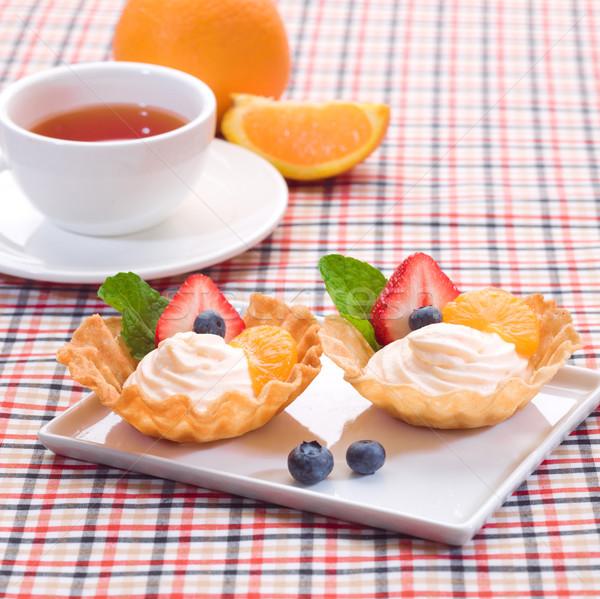 Yogurt cupcake topping with mint and strawberry Stock photo © JohnKasawa