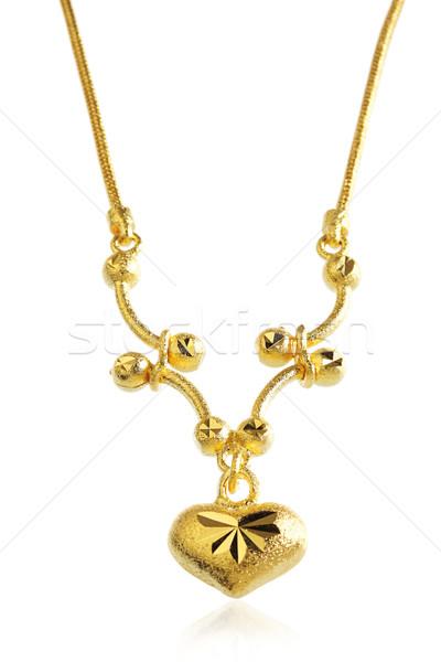 Dourado colar forma de coração projeto cor dom Foto stock © JohnKasawa