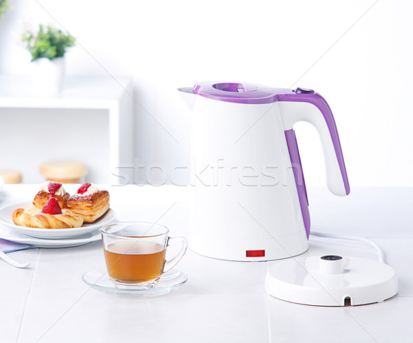 White kettle electric water boiler isolates in the kitchen  Stock photo © JohnKasawa