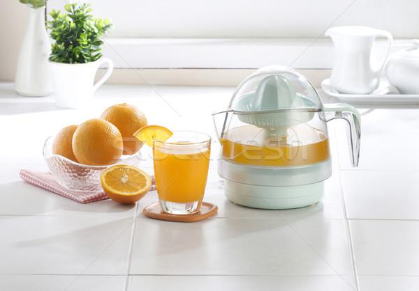 Orange juice blender tool in the kitchen Stock photo © JohnKasawa