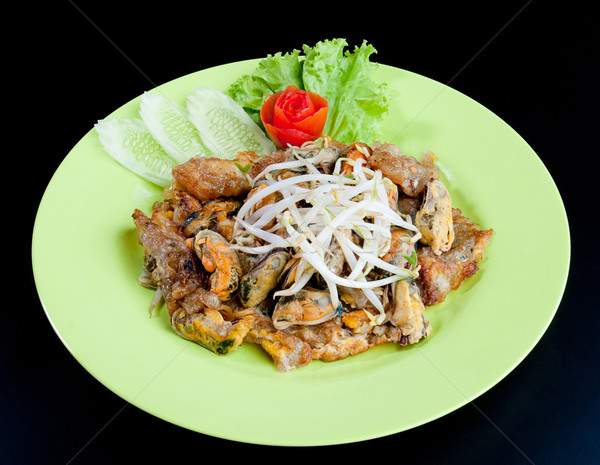 Stir fried mussel topping with bean sprout the thai food favorit Stock photo © JohnKasawa