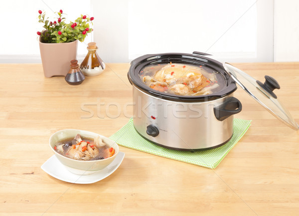 Electric casserole or stew pot on the wooden kitchen cabinet Stock photo © JohnKasawa