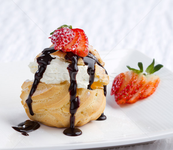 Choux cream snack topping with strawberry on dish  Stock photo © JohnKasawa