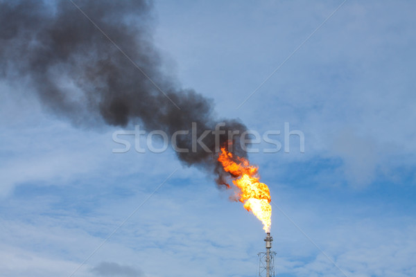Smokestack draining smokes and fire Stock photo © JohnKasawa