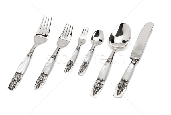 Stainless steel spoons set with pearl handle bar for classical o Stock photo © JohnKasawa