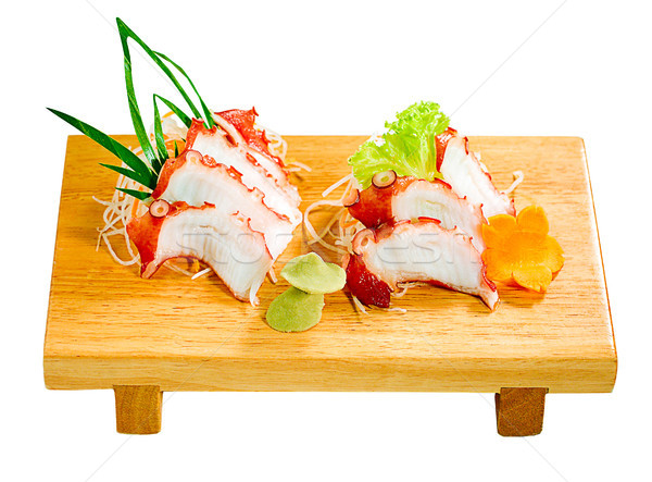 The octopus slices on wooden bench one of the Japanese food menu Stock photo © JohnKasawa