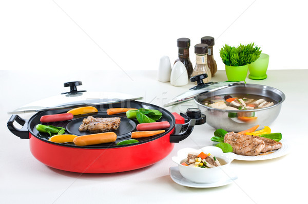 Electric barbecue and cooking pot a useful kitchenware Stock photo © JohnKasawa
