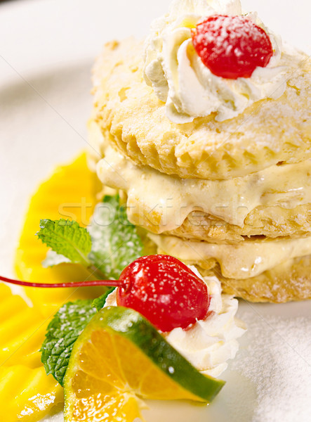 Sweet dessert cake topping with mousse and cherry  Stock photo © JohnKasawa