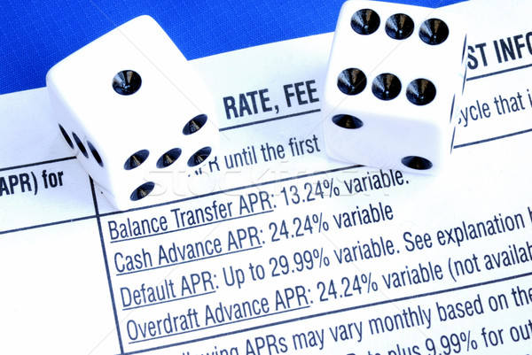 Borrow money from a credit card is like gambling isolated on blue Stock photo © johnkwan