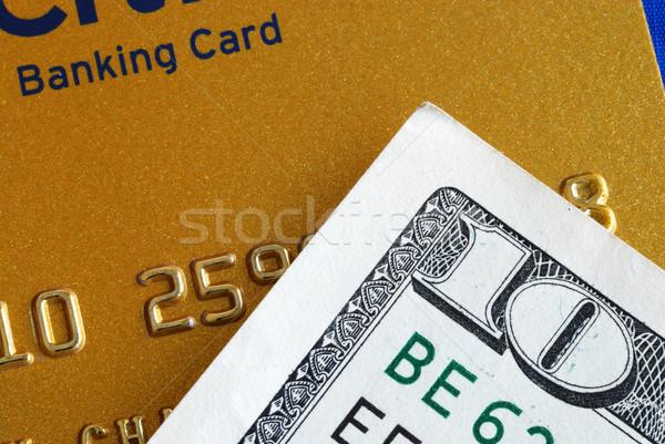 Ten dollar bill and a credit card concepts of finance Stock photo © johnkwan