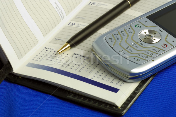 Stock photo: Phone pen and notebook concepts of office tools