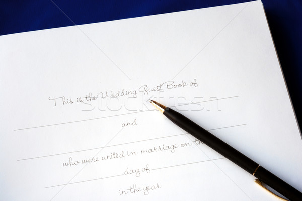 The first page of a wedding guest book isolated on blue Stock photo © johnkwan