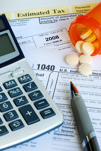 Stress inkomen belasting terugkeren pillen Stockfoto © johnkwan