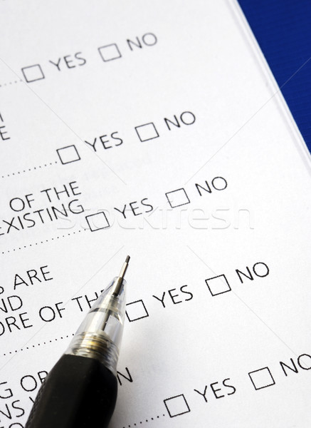 Stock photo: Select Yes or No from a questionnaire isolated on blue